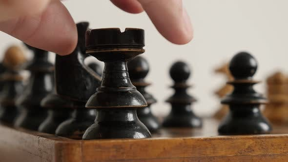 Thumbnail for Ancient wooden chess set figures on playing table  4K 2160p 30fps UltraHD  footage - Black pawn move