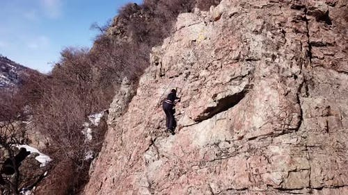 A Group of People are Engaged in Rock Climbing