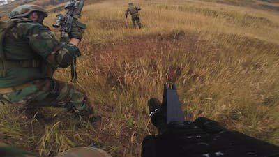 POV Of Soldiers Running Through FIeld