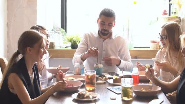 Thumbnail for Multi Ethnic People Talking About Work While They Eating.