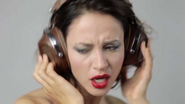 Thumbnail for Young Woman Dances And Poses With Headphones 11