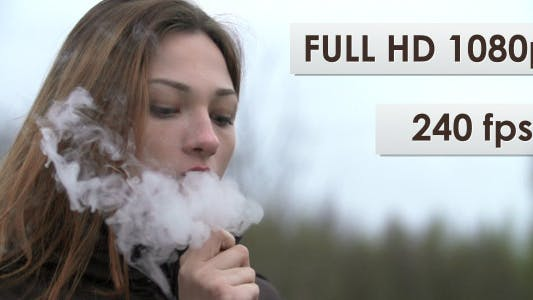 Young Woman Smoking A Hookah