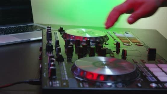 Thumbnail for DJ Using His Mixer Table 13B
