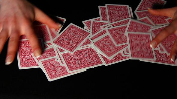 Thumbnail for Woman Hand Shuffle Poker Cards On Black Background