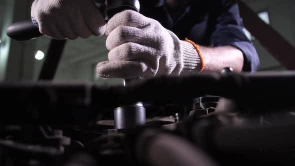 Thumbnail for Auto Mechanic Replacing Car Oil Filter During Work