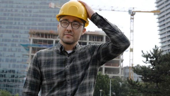 Thumbnail for Handsome Architect Man Wearing Hard Hat Walking from Construction