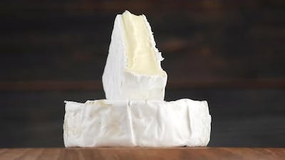 camembert or brie cheese rotation. Soft, creamy cheese. 4K UHD video