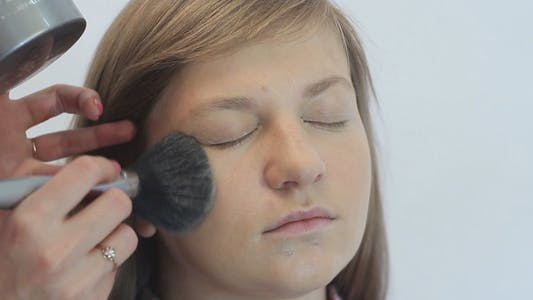 Thumbnail for Makeup Artist Puts Powder on the Face