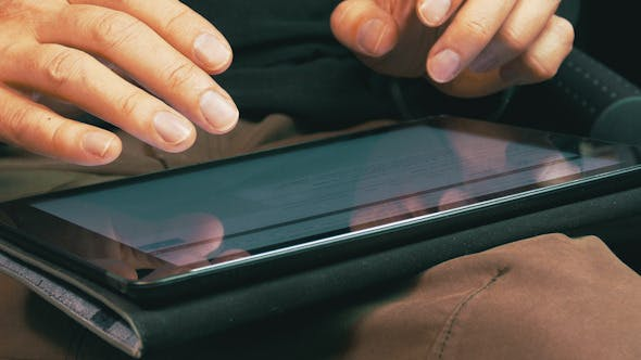 Thumbnail for Male Hands Typing on a Tablet Computer