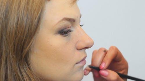 Makeup Artist Applies Makeup