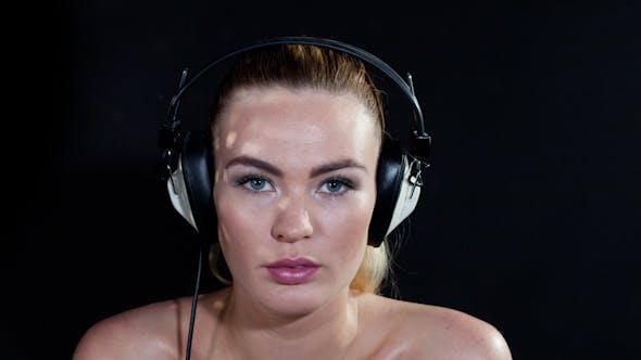 Thumbnail for Blonde Girl Dances Headphones