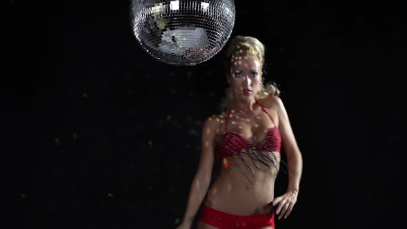 Thumbnail for Gogo Dancing Next To A Large Spinning Discoball 12