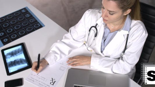 Thumbnail for Female Doctor Writing Prescription