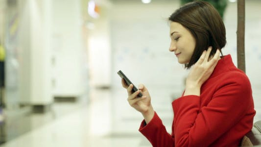 Thumbnail for Woman Typing on Mobile Phone in the Mall