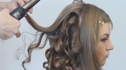 Thumbnail for Stylist Hairdresser Makes Hairdress Beautiful Girl