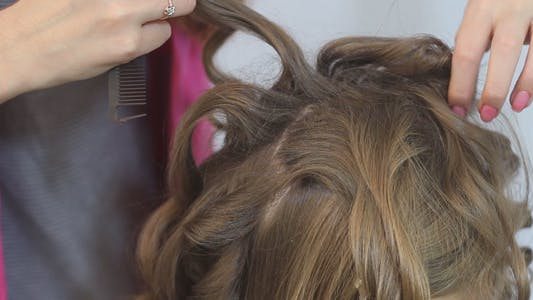 Thumbnail for Professional Stylist Makes Hairstyle