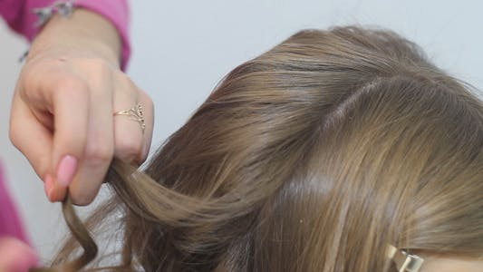 Professional Stylist Hairdresser Makes Hairstyle