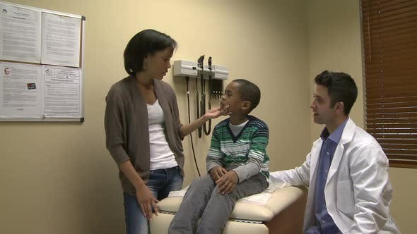 Concerned Mom With Her Son At Doctors Office - product preview 0