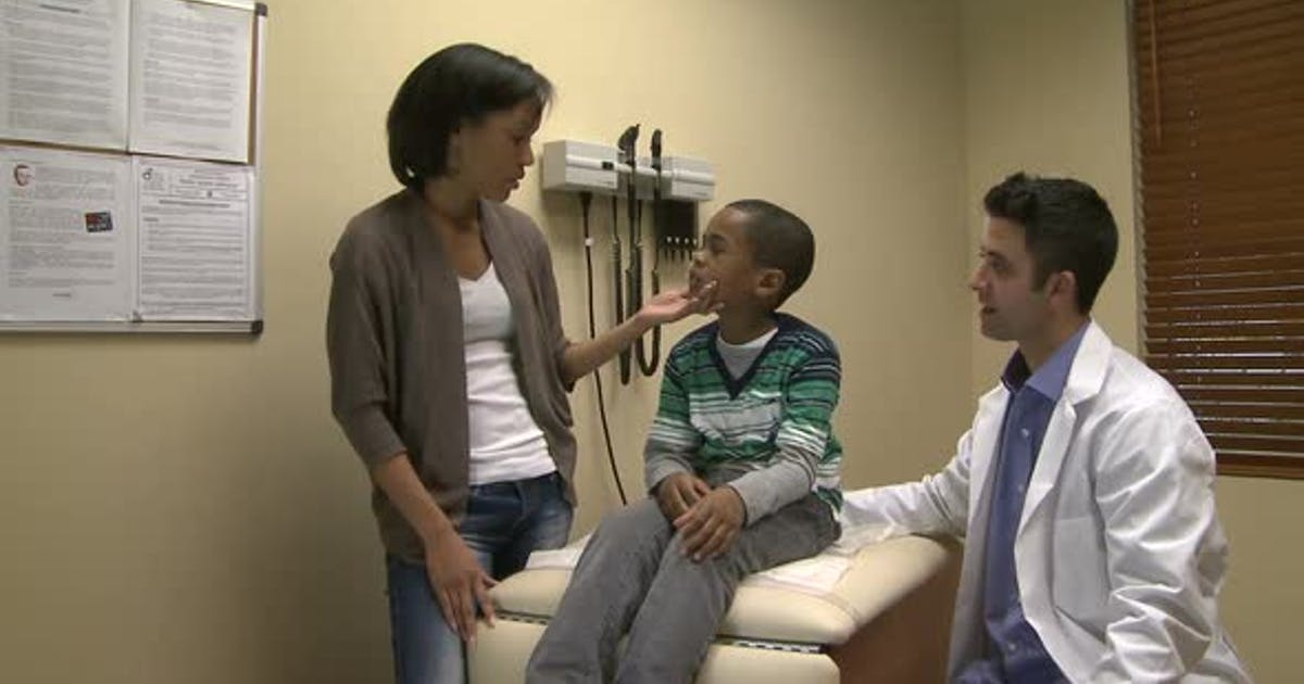 Concerned Mom With Her Son At Doctors Office