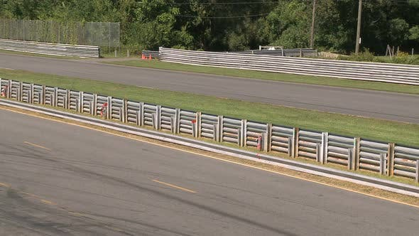 Thumbnail for Race Cars Going By Fenced Area (2 Of 2)