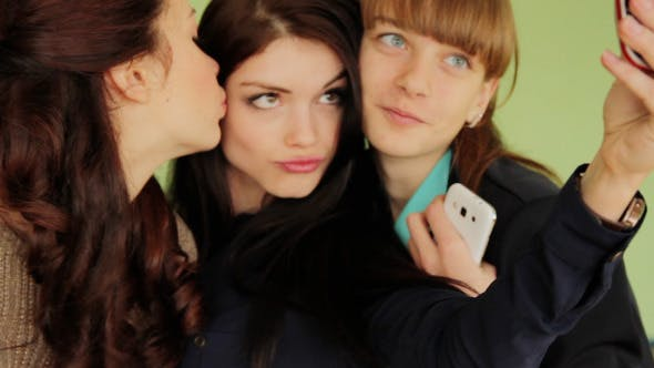 Thumbnail for Group Of Girls Photographed On Mobile Phones