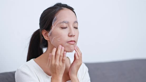 Thumbnail for Woman apply paper mask on face at home