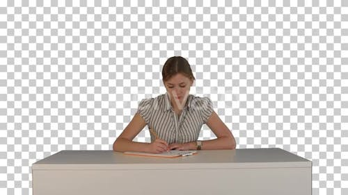 Young girl sitting in classroom at lecture, Alpha Channel