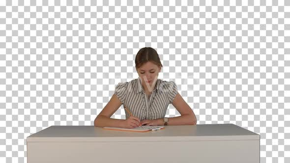 Thumbnail for Young girl sitting in classroom at lecture, Alpha Channel