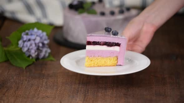 Thumbnail for Piece of Layered Berry Mousse Cake With Mirror Glaze.