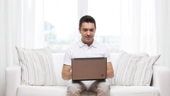 Cover Image for Man Working with Laptop Computer at Home