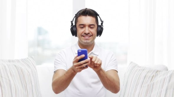 Thumbnail for Happy Man With Smartphone And Headphones