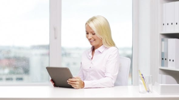 Cover Image for Smiling Businesswoman Or Student With Tablet Pc