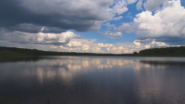 Cover Image for Forest Lake under a Sky with Clouds