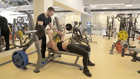 Thumbnail for Woman Performs Barbell Bench Press in the Gym
