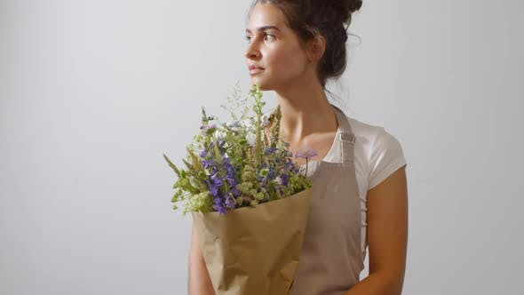 Thumbnail for Brunette Florist Posing with Wildflower Bouquet