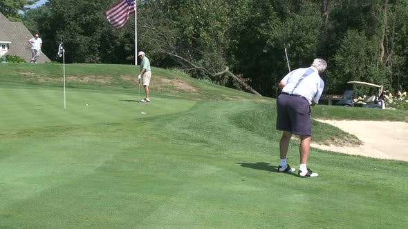Thumbnail for Golfer Chipping Onto Green (2 Of 2)
