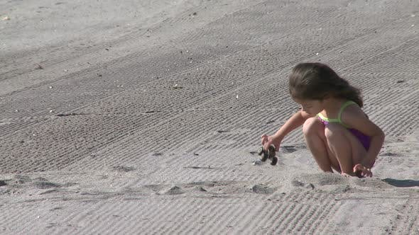 Thumbnail for Young Girl Playing At Beach