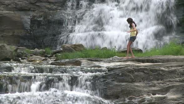 Thumbnail for Young Girl Wading Across The Waterfalls