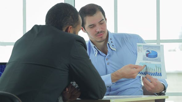 Thumbnail for Two Confident Businessman Considered Business Plan