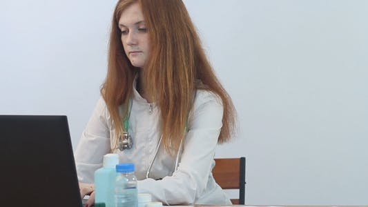 Thumbnail for Beautiful Female Doctor Working on Computer