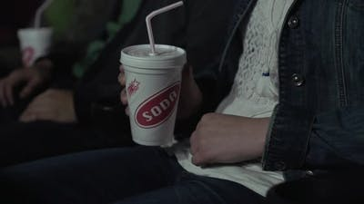 Drinking A Soda At The Movies