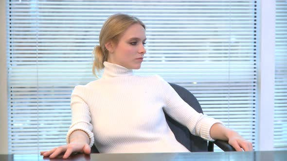 Thumbnail for Professional Female Behind Desk Turns And Smiles At Camera (1 Of 2)