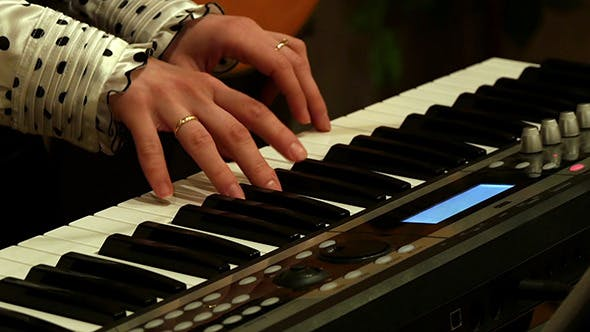 Thumbnail for Musician Play Piano Synthesizer