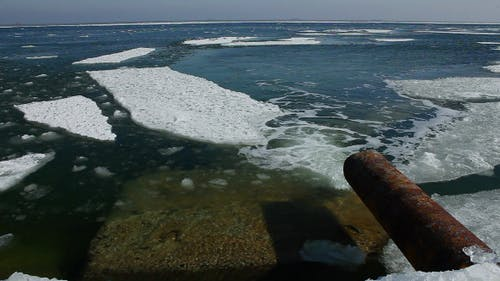 Sewage Pipe Merges into the Sea