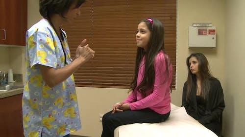 Nurse Checks Patients Vitals