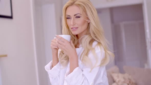 Thumbnail for Alluring Blond Woman With Coffee Looking At Camera 1
