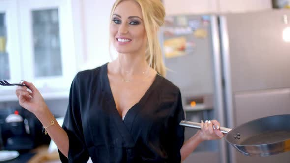 Thumbnail for Pretty Blond Woman Making The Dinner 5