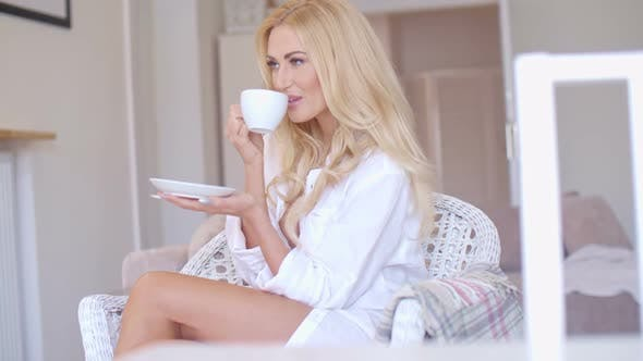 Thumbnail for Happy Blond Woman In White Drinking Coffee 1