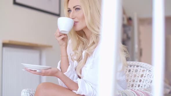 Thumbnail for Happy Blond Woman In White Drinking Coffee 2