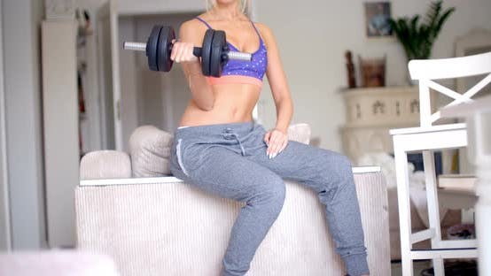 Thumbnail for Sexy Sporty Blond Woman Exercising With Weights 1